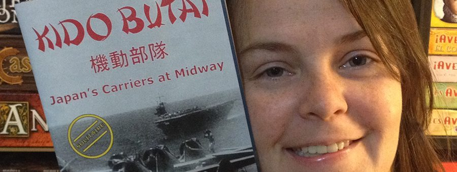 Molly holding a copy of Kido Butai