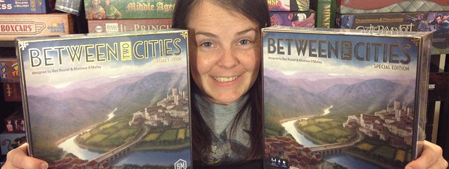 Molly holding 2 copies of Between Two Cities