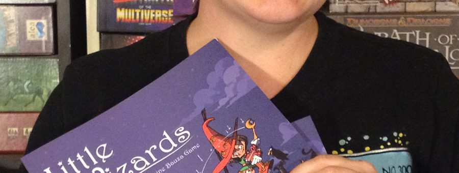 Molly with two copies of Little Wizards