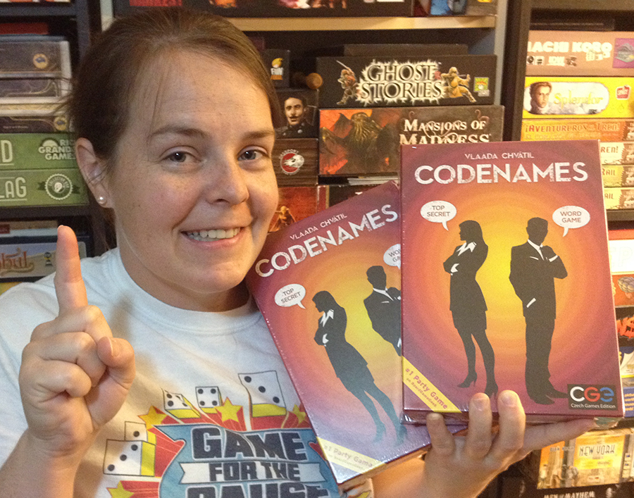 Molly with two copies of Codenames
