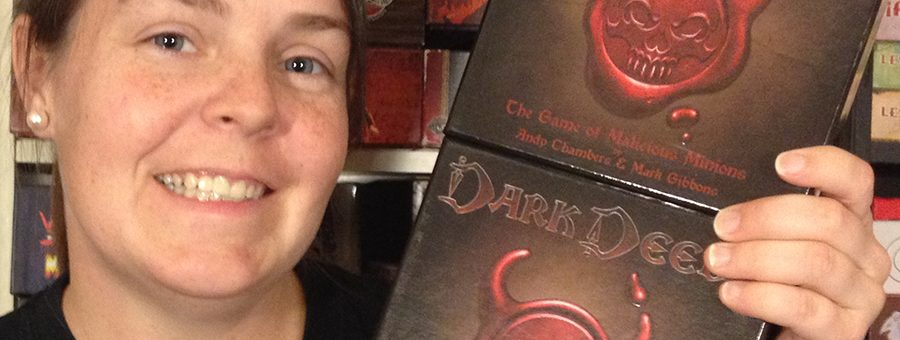Molly with two copies of Dark Deeds