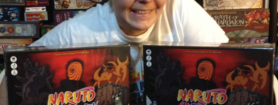 Molly with two copies of Naruto Shippuden board game